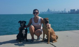 Danielle running with dogs by lake
